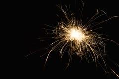 Крупный план бенгальского огня партии Нового Года на черной предпосылке Стоковая Фотография