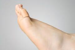 Крупный план гипсолита на женском пальце ноги Стоковая Фотография RF