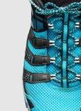 Крупный план голубых шнурков на сером цвете Стоковые Фотографии RF