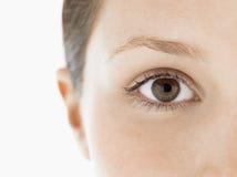 Крупный план глаза молодой женщины стоковое фото rf