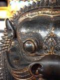 Крупный план глаз статуи старой Азии с нерезкостью движения предпосылки Стоковые Изображения