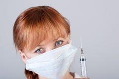 Крупный план женского доктора с шприцем Стоковое фото RF