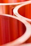 Крупный план листовой меди в кренах от выбранного фокуса Стоковые Фото
