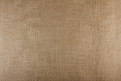 Крупный план коричневой текстурированной поверхности, предпосылки текстуры мешковины Стоковые Фотографии RF