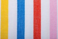 Крупный план красочной striped ткани как предпосылка или текстура стоковое фото rf