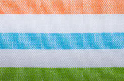 Крупный план красочной striped ткани как предпосылка или текстура стоковое фото