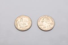 Крупный план к символу положения Алабамы на монетке квартального доллара на белой предпосылке Стоковые Изображения RF