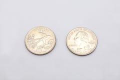 Крупный план к символу положения Оклахомы на монетке квартального доллара на белой предпосылке Стоковое Фото