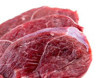 Крупный план макроса стейков мяса овечки ноги изолированных на белизне стоковая фотография rf