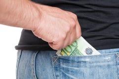 Крупный план мужчины кладя 100 евро Стоковая Фотография