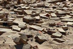 Крупный план на плитках кирпича здания глины в песке Стоковая Фотография