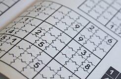 Крупный план незаконченной головоломки sudoku Стоковое Изображение