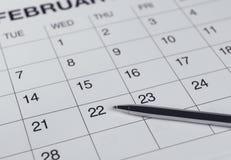 Крупный план номеров на странице календаря Стоковые Изображения RF