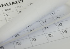 Крупный план номеров на странице календаря Стоковое Изображение