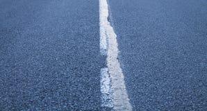 Крупный план дороги асфальта Стоковые Изображения RF
