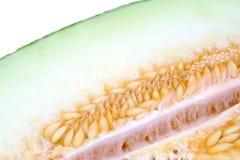 Крупный план половины дыни показывая семена Piel de Стоковое фото RF