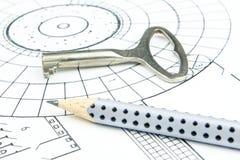 Крупный план плана строительства с карандашем и старым ключом Стоковые Изображения