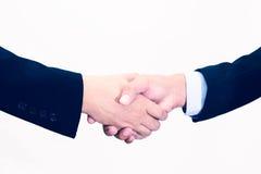 Крупный план рукопожатия businessmans изолированный на белой предпосылке Стоковые Изображения RF