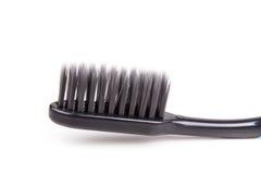 Крупный план щетинки угля зубной щетки мягкой и тонкой сплющенной Стоковое фото RF