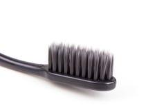 Крупный план щетинки угля зубной щетки мягкой и тонкой сплющенной Стоковые Фото