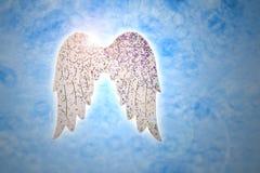 Крыла на голубых изображениях запаса предпосылки Стоковая Фотография RF