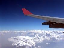 Крыло над облаком Стоковые Фото