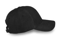 Крышка бейсбола черная изолированная на белой предпосылке Стоковые Фотографии RF