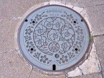 Крышка люка города Осака, Японии Стоковое Фото