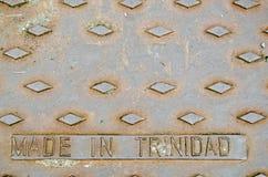 Крышка стока литого железа Тринидада Стоковое Изображение RF