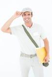 Крышка счастливого работника доставляющего покупки на дом нося Стоковая Фотография