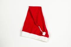 Крышка Santas красная на белизне Стоковые Изображения
