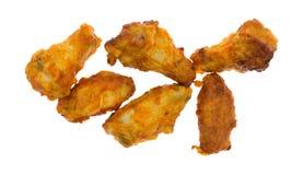 Крыла цыпленка вкуса буйвола и бедренные кости на белой предпосылке Стоковое Изображение
