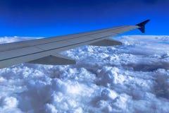 Крыло над облаками Стоковые Фото