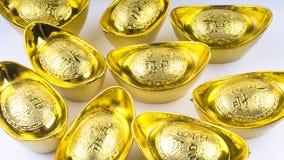 Куала-Лумпур, Малайзия - 13-ое декабря 2017: Крупный план китайского нового золота Sycees Year's или золотого ингота Стоковые Изображения
