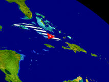 Куба с флагом на земле Стоковые Изображения