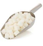 Кубики сахара на белизне стоковая фотография