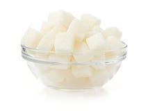 Кубики сахара на белой предпосылке стоковые фото