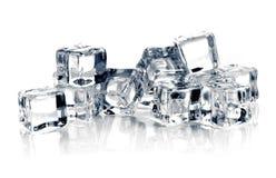 Кубики льда на белой предпосылке Стоковая Фотография