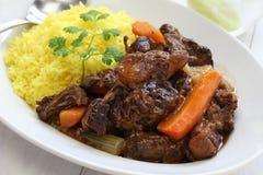 Кубинськое тушёное мясо oxtail с желтым рисом Стоковые Фото