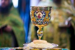 Кубок для общности в правоверном монастыре kiev Стоковое Фото