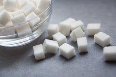 Кубы сахара на серой предпосылке Стоковое Изображение