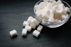 Кубы сахара на черной предпосылке Стоковые Изображения RF