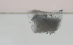 Куб льда в воде Стоковая Фотография RF