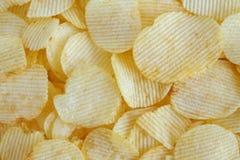 Кудрявая предпосылка текстуры закуски картофельных стружек стоковое изображение rf