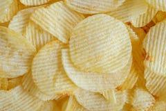 Кудрявая предпосылка текстуры закуски картофельных стружек стоковые фото