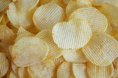 Кудрявая предпосылка текстуры закуски картофельных стружек стоковые изображения rf