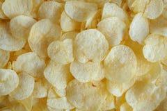 Кудрявая предпосылка текстуры закуски картофельных стружек стоковая фотография