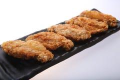 Кудрявые крыла жареной курицы Стоковые Изображения RF