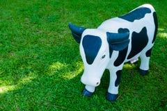 Кукла коровы в саде Стоковое фото RF