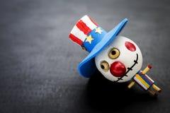 Кукла призрака Bozo деревянная на черной предпосылке стоковое фото